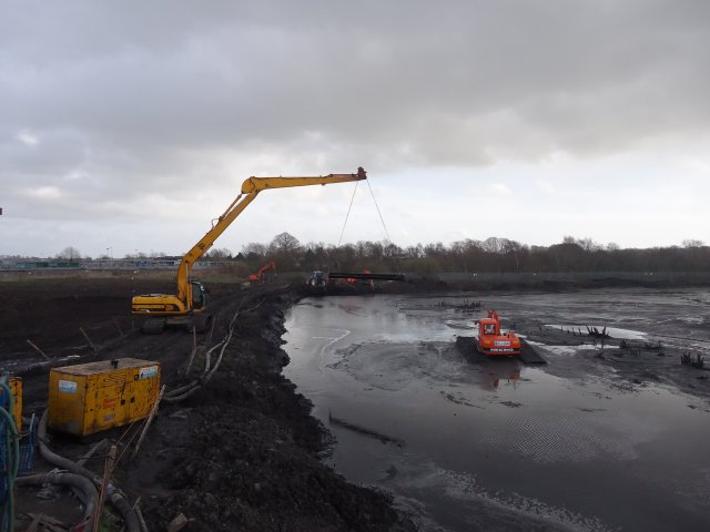 - Here the amphibious excavator was tasked with emptying sewage sludge lagoons in an environmental clean up operation. The pits were upto 4 metres deep and no other machine could manoeuvre in the soft conditions.